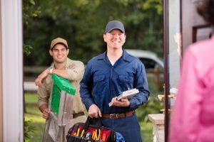 two-technicians-door-ladder
